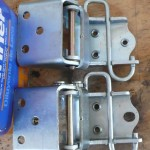 Comparison of hinges - the upper hinge has not had the threads drilled out... while the lower hinge has had the threaded hole drilled out and enlarged/slotted somewhat.