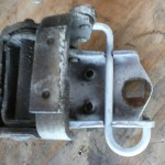 This is a photo of the old hinge showing the &quot;hole&quot; in place of a threaded hole on the new hinges.  The new replacement hinges must be drilled out to mimic the original Chrysler design.  I guess some Mopars need the threaded hole, but the trucks use a thru- hole.